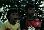 Image of Vietnamese refugees listen to music Florida United States USA, 1975, second 39 stock footage video 65675050947