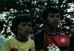 Image of Vietnamese refugees listen to music Florida United States USA, 1975, second 40 stock footage video 65675050947
