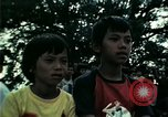 Image of Vietnamese refugees listen to music Florida United States USA, 1975, second 41 stock footage video 65675050947