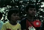 Image of Vietnamese refugees listen to music Florida United States USA, 1975, second 42 stock footage video 65675050947