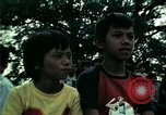 Image of Vietnamese refugees listen to music Florida United States USA, 1975, second 43 stock footage video 65675050947