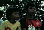 Image of Vietnamese refugees listen to music Florida United States USA, 1975, second 44 stock footage video 65675050947