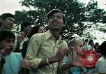 Image of Vietnamese refugees listen to music Florida United States USA, 1975, second 45 stock footage video 65675050947