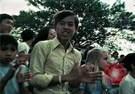 Image of Vietnamese refugees listen to music Florida United States USA, 1975, second 46 stock footage video 65675050947