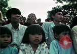 Image of Vietnamese refugees listen to music Florida United States USA, 1975, second 48 stock footage video 65675050947