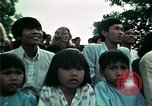 Image of Vietnamese refugees listen to music Florida United States USA, 1975, second 49 stock footage video 65675050947