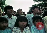 Image of Vietnamese refugees listen to music Florida United States USA, 1975, second 50 stock footage video 65675050947