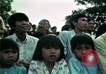 Image of Vietnamese refugees listen to music Florida United States USA, 1975, second 51 stock footage video 65675050947