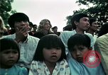 Image of Vietnamese refugees listen to music Florida United States USA, 1975, second 52 stock footage video 65675050947