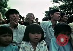 Image of Vietnamese refugees listen to music Florida United States USA, 1975, second 53 stock footage video 65675050947