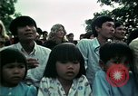 Image of Vietnamese refugees listen to music Florida United States USA, 1975, second 54 stock footage video 65675050947