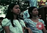 Image of Vietnamese refugees listen to music Florida United States USA, 1975, second 56 stock footage video 65675050947