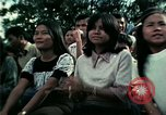 Image of Vietnamese refugees listen to music Florida United States USA, 1975, second 57 stock footage video 65675050947