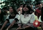 Image of Vietnamese refugees listen to music Florida United States USA, 1975, second 58 stock footage video 65675050947