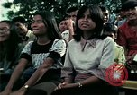 Image of Vietnamese refugees listen to music Florida United States USA, 1975, second 59 stock footage video 65675050947