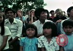 Image of Vietnamese refugees listen to music Florida United States USA, 1975, second 60 stock footage video 65675050947