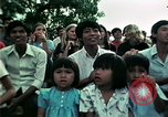Image of Vietnamese refugees listen to music Florida United States USA, 1975, second 61 stock footage video 65675050947