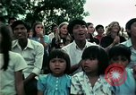 Image of Vietnamese refugees listen to music Florida United States USA, 1975, second 62 stock footage video 65675050947