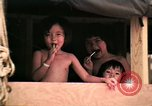Image of Vietnamese refugee children eat candy Florida United States USA, 1975, second 16 stock footage video 65675050958