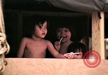 Image of Vietnamese refugee children eat candy Florida United States USA, 1975, second 20 stock footage video 65675050958
