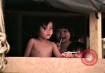 Image of Vietnamese refugee children eat candy Florida United States USA, 1975, second 21 stock footage video 65675050958