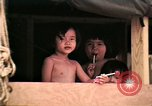 Image of Vietnamese refugee children eat candy Florida United States USA, 1975, second 23 stock footage video 65675050958
