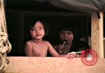 Image of Vietnamese refugee children eat candy Florida United States USA, 1975, second 26 stock footage video 65675050958