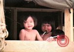 Image of Vietnamese refugee children eat candy Florida United States USA, 1975, second 27 stock footage video 65675050958