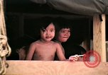 Image of Vietnamese refugee children eat candy Florida United States USA, 1975, second 29 stock footage video 65675050958