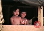 Image of Vietnamese refugee children eat candy Florida United States USA, 1975, second 31 stock footage video 65675050958