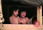 Image of Vietnamese refugee children eat candy Florida United States USA, 1975, second 32 stock footage video 65675050958