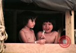 Image of Vietnamese refugee children eat candy Florida United States USA, 1975, second 35 stock footage video 65675050958
