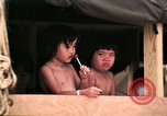Image of Vietnamese refugee children eat candy Florida United States USA, 1975, second 36 stock footage video 65675050958