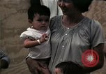Image of Vietnamese refugee children eat candy Florida United States USA, 1975, second 45 stock footage video 65675050958