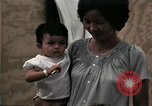 Image of Vietnamese refugee children eat candy Florida United States USA, 1975, second 46 stock footage video 65675050958
