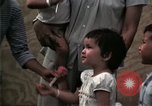 Image of Vietnamese refugee children eat candy Florida United States USA, 1975, second 47 stock footage video 65675050958