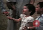 Image of Vietnamese refugee children eat candy Florida United States USA, 1975, second 48 stock footage video 65675050958