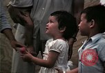 Image of Vietnamese refugee children eat candy Florida United States USA, 1975, second 49 stock footage video 65675050958