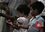Image of Vietnamese refugee children eat candy Florida United States USA, 1975, second 50 stock footage video 65675050958