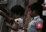 Image of Vietnamese refugee children eat candy Florida United States USA, 1975, second 51 stock footage video 65675050958