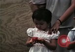 Image of Vietnamese refugee children eat candy Florida United States USA, 1975, second 56 stock footage video 65675050958