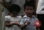 Image of Vietnamese refugee children eat candy Florida United States USA, 1975, second 59 stock footage video 65675050958