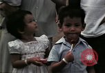 Image of Vietnamese refugee children eat candy Florida United States USA, 1975, second 60 stock footage video 65675050958