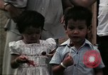 Image of Vietnamese refugee children eat candy Florida United States USA, 1975, second 61 stock footage video 65675050958