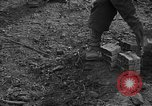 Image of road cleared of land mines using explosive charges Emelie France, 1944, second 36 stock footage video 65675051321