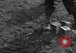 Image of road cleared of land mines using explosive charges Emelie France, 1944, second 39 stock footage video 65675051321