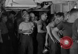 Image of United States Navy sailors enjoy ice cream Pacific Ocean, 1954, second 5 stock footage video 65675051350