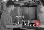 Image of United States Navy sailors enjoy ice cream Pacific Ocean, 1954, second 14 stock footage video 65675051350