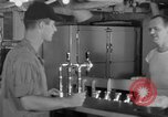 Image of United States Navy sailors enjoy ice cream Pacific Ocean, 1954, second 15 stock footage video 65675051350