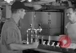 Image of United States Navy sailors enjoy ice cream Pacific Ocean, 1954, second 16 stock footage video 65675051350